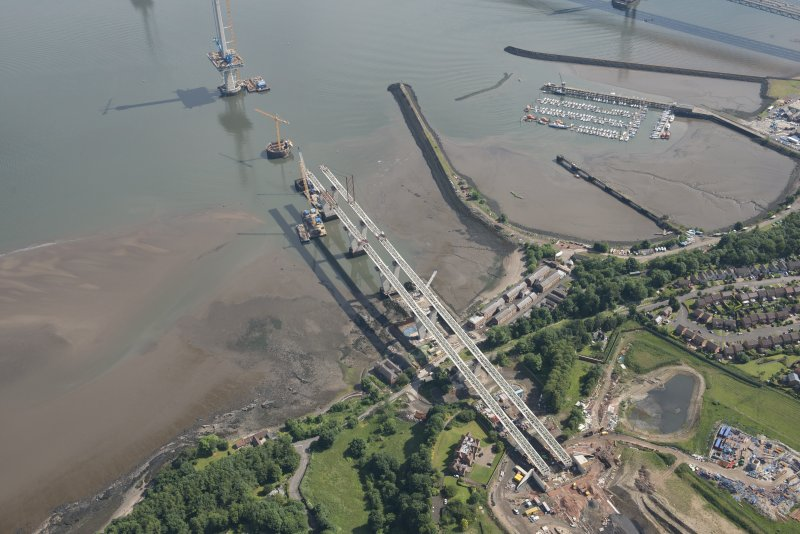 Oblique aerial view of the construction of the Queensferry Crossing and Port Edgar, looking NE.
