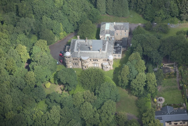 Oblique aerial view of Beechmount House, looking NW.