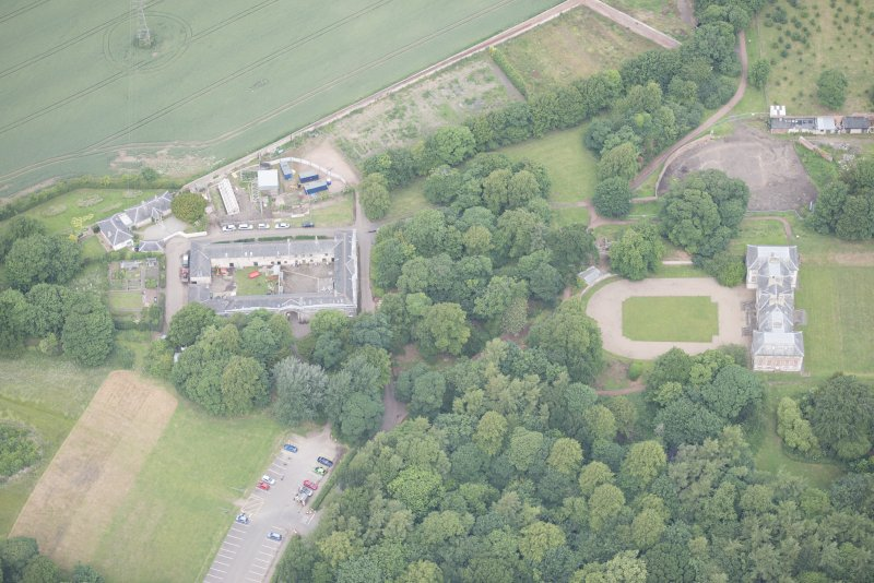 Oblique aerial view of Newhailes House and stables, looking NW.