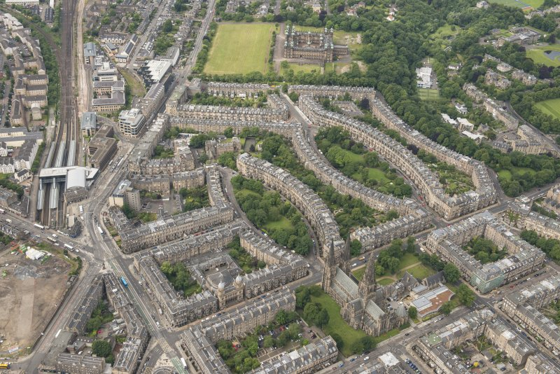 Oblique aerial view of the Western New Town, Palmerston Place, Walpole Hall, Easter Coates House and St Mary's Episcopal Church, looking WSW.