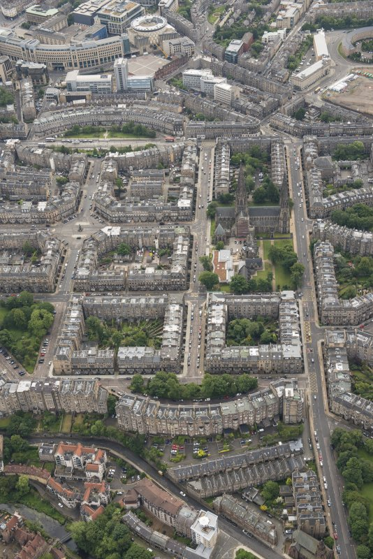 Oblique aerial view of the eestern New Town, Palmerston Place, Walpole Hall, Easter Coates House, St Mary's Episcopal Church and Song School, looking NW.