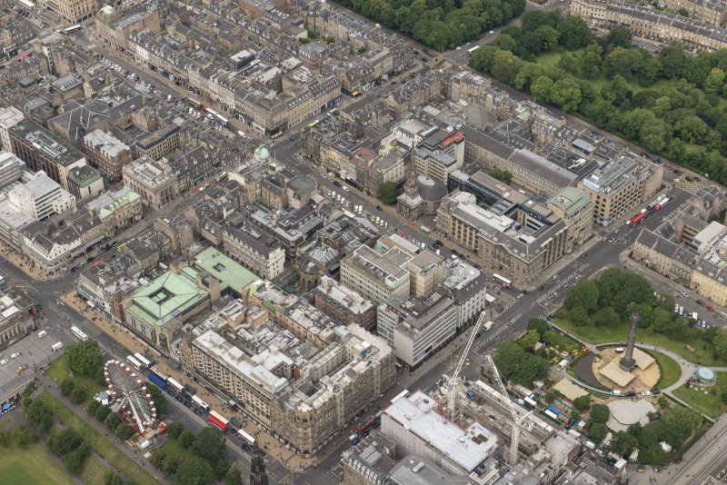 Oblique aerial view of South St David Street, George Street, Princes Street and Jenners Department Store, looking NW.