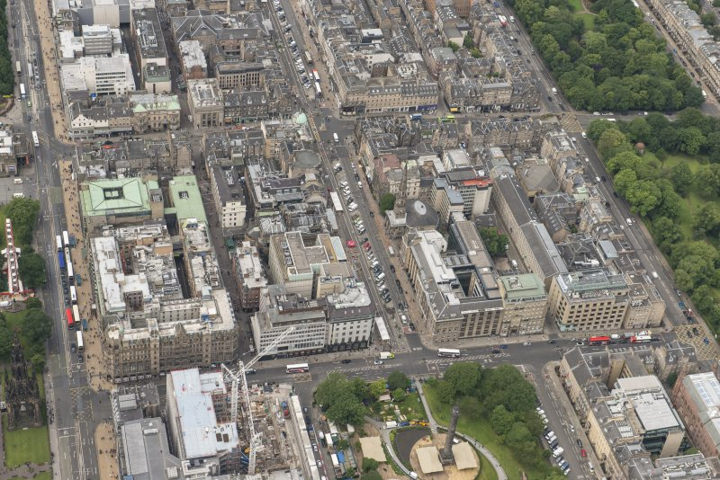 Oblique aerial view of South St David Street, George Street, Princes Street and Jenners Department Store, looking WSW.
