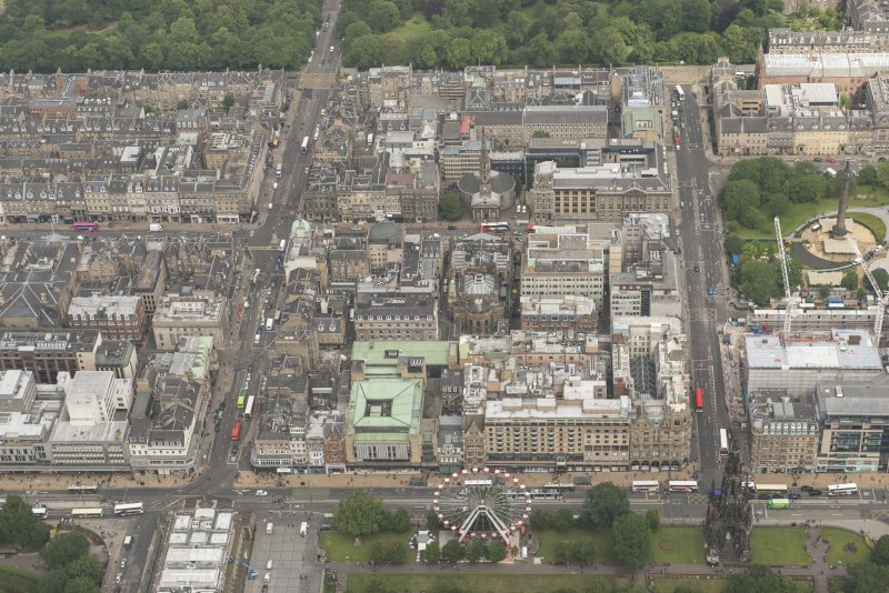 Oblique aerial view of George Street, South St David Street, Princes Street and Jenners Department Store, looking NNW.