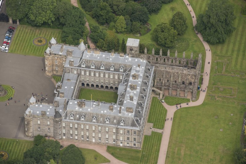 Oblique aerial view of Holyrood Palace and Holyrood Abbey, looking NW.