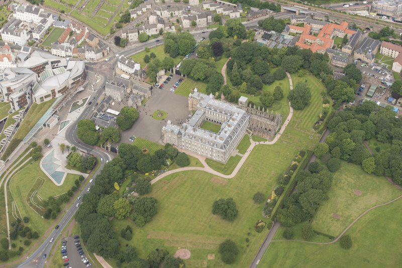 Oblique aerial view of Holyrood Palace and Holyrood Abbey, looking WNW.
