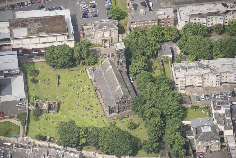 Oblique aerial view of Trinity House and South Leith Parish Church and Churchyard, looking WNW.