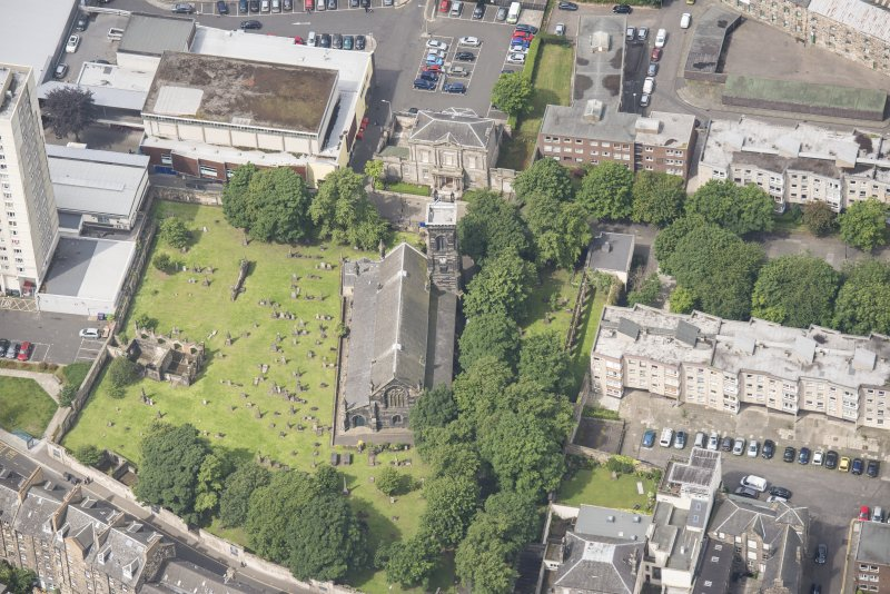 Oblique aerial view of Trinity House and South Leith Parish Church and Churchyard, looking W.