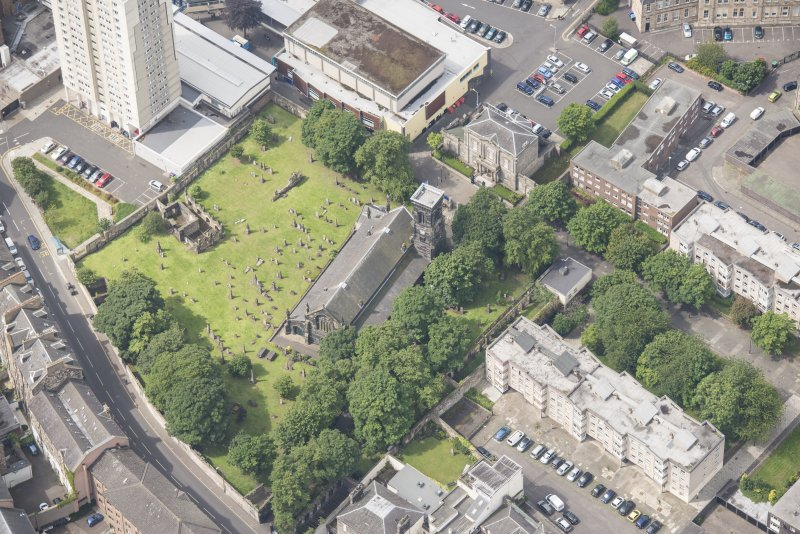 Oblique aerial view of Trinity House and South Leith Parish Church and Churchyard, looking WSW.