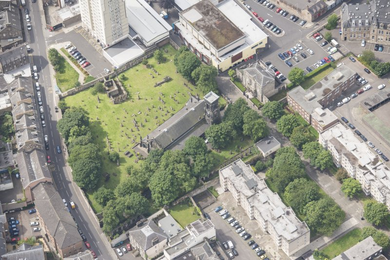 Oblique aerial view of Trinity House and South Leith Parish Church and Churchyard, looking SW.