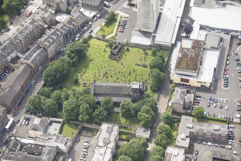 Oblique aerial view of Trinity House and South Leith Parish Church and Churchyard, looking S.