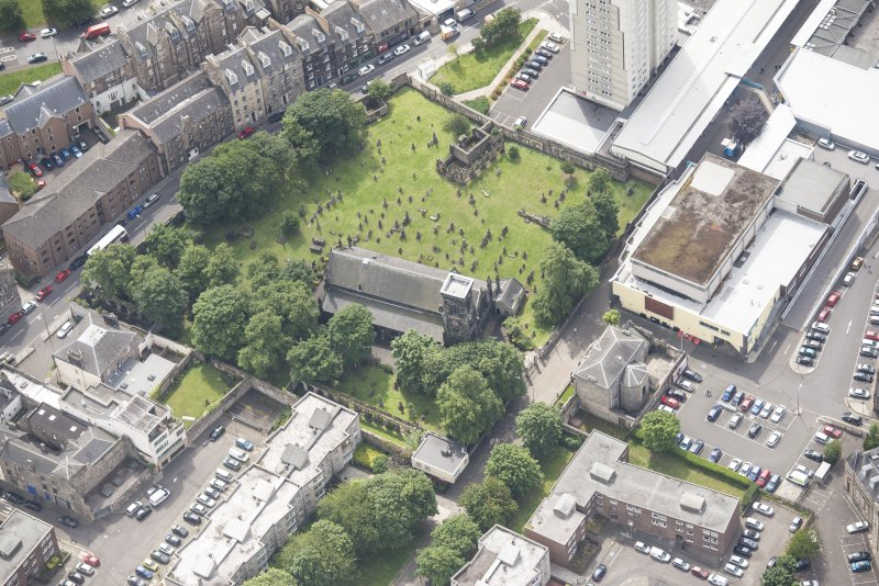 Oblique aerial view of Trinity House and South Leith Parish Church and Churchyard, looking SSE.