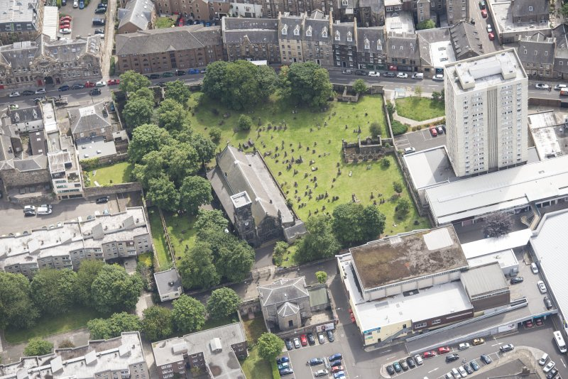 Oblique aerial view of Trinity House and South Leith Parish Church and Churchyard, looking ESE.