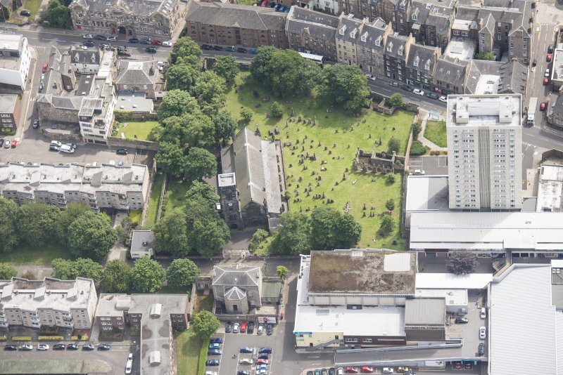 Oblique aerial view of Trinity House and South Leith Parish Church and Churchyard, looking E.