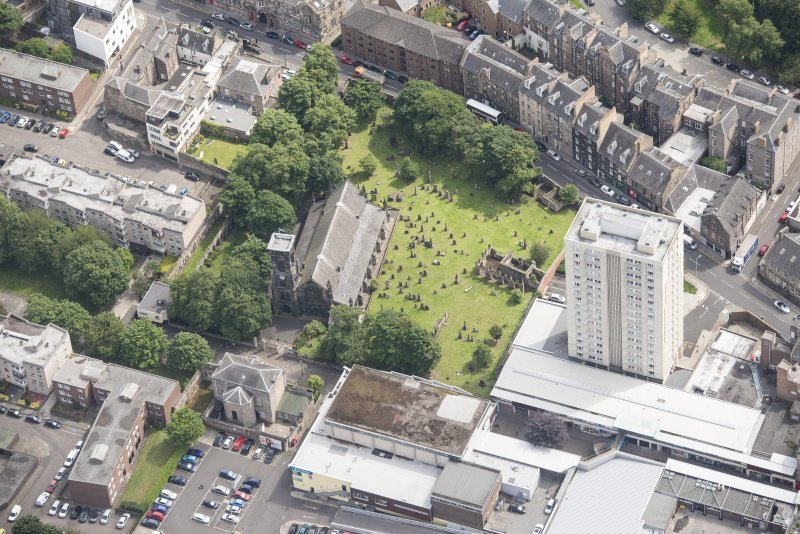 Oblique aerial view of Trinity House and South Leith Parish Church and Churchyard, looking ENE.