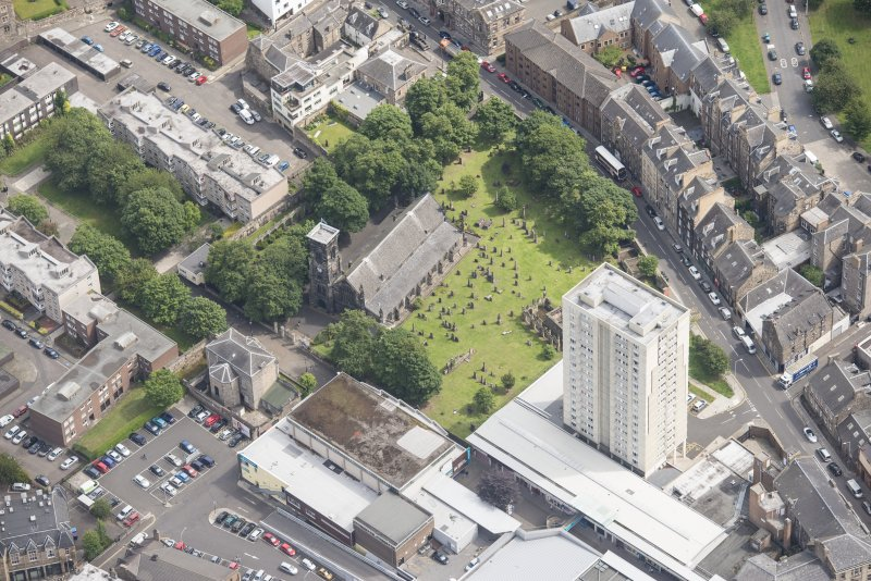 Oblique aerial view of Trinity House and South Leith Parish Church and Churchyard, looking NE.