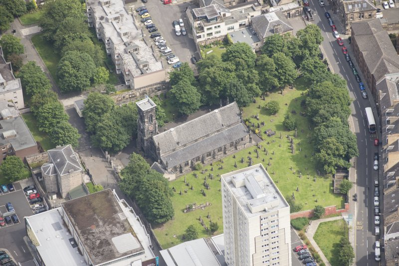 Oblique aerial view of Trinity House and South Leith Parish Church and Churchyard, looking NNE.