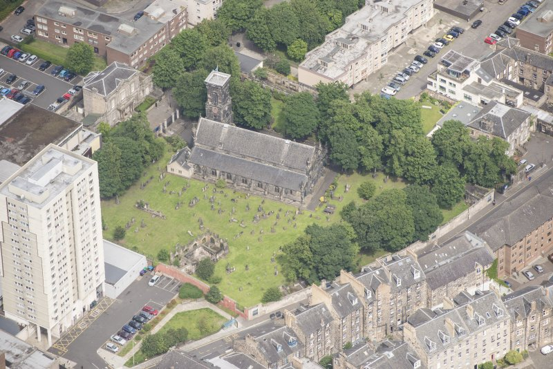 Oblique aerial view of Trinity House and South Leith Parish Church and Churchyard, looking NNW.