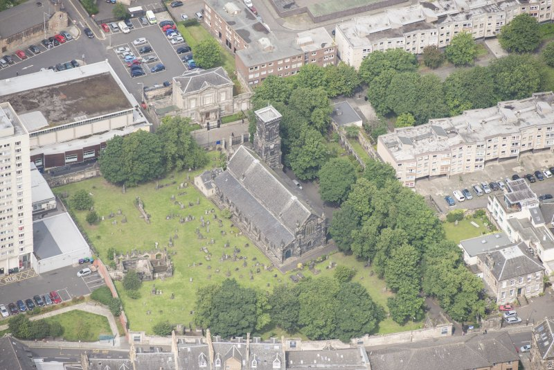 Oblique aerial view of Trinity House and South Leith Parish Church and Churchyard, looking NW.
