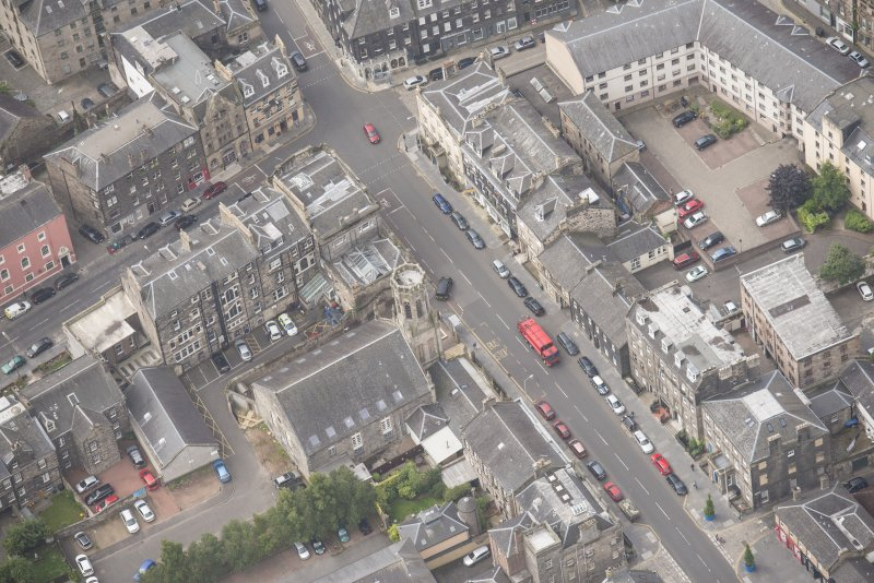 Oblique aerial view of St John's East Church, Bank of Scotland, 31-33 Queen Charlotte Street, 41 Queen Charlotte Street, 75-79 Constitution Street and 35-39 Queen Charlotte Street, looking SW.