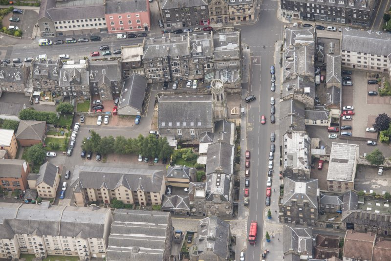 Oblique aerial view of St John's East Church, Bank of Scotland, 31-33 Queen Charlotte Street, 41 Queen Charlotte Street, 75-79 Constitution Street and 35-39 Queen Charlotte Street, looking SSW.