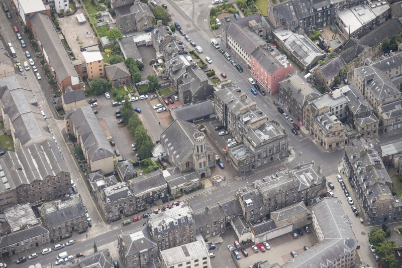 Oblique aerial view of St John's East Church, Bank of Scotland, 31-33 Queen Charlotte Street, 41 Queen Charlotte Street, 75-79 Constitution Street and 35-39 Queen Charlotte Street, looking SE.