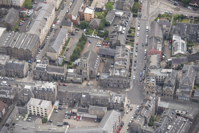 Oblique aerial view of St John's East Church, Bank of Scotland, 31-33 Queen Charlotte Street, 41 Queen Charlotte Street, 75-79 Constitution Street and 35-39 Queen Charlotte Street, looking ESE.