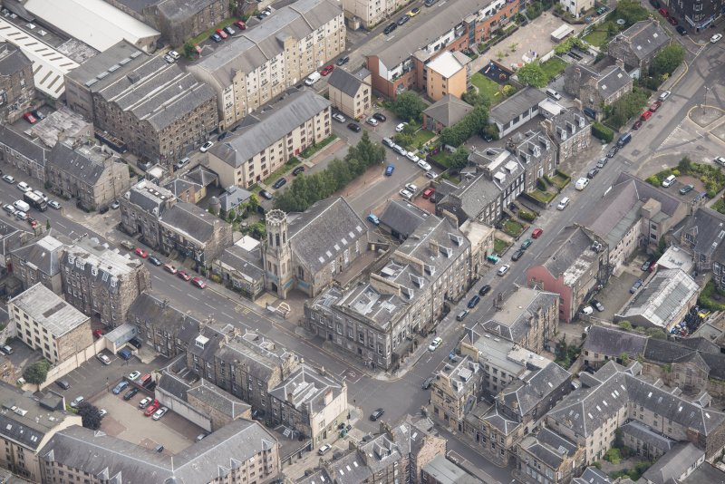 Oblique aerial view of St John's East Church, Bank of Scotland, 31-33 Queen Charlotte Street, 41 Queen Charlotte Street, 75-79 Constitution Street and 35-39 Queen Charlotte Street, looking E.
