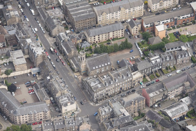 Oblique aerial view of St John's East Church and Bank of Scotland, looking NE.