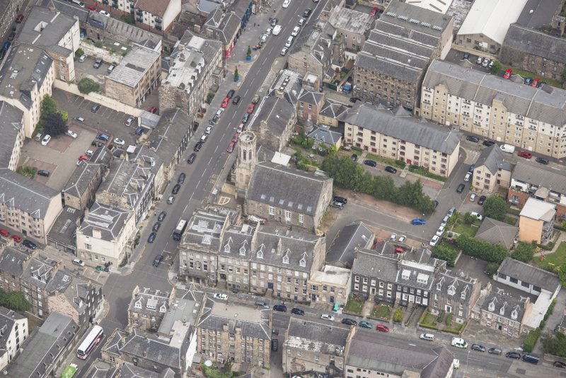 Oblique aerial view of St John's East Church, Bank of Scotland, 31-33 Queen Charlotte Street, 41 Queen Charlotte Street, 75-79 Constitution Street and 35-39 Queen Charlotte Street, 41 Queen Charlotte Street, 75-79 Constitution Street and 35-39 Queen Charlotte Street, looking N.
