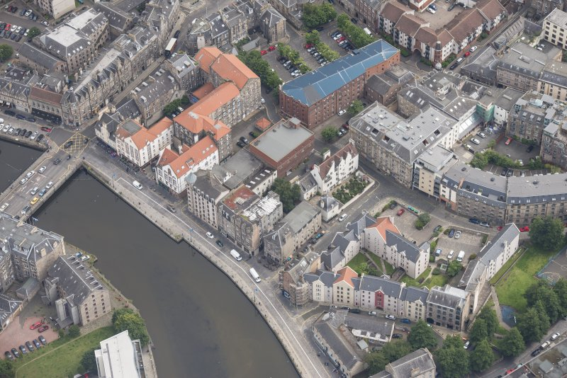 Oblique aerial view of 59-63 Bernard Street, the National Commercial Bank of Scotland, 24-25 Maritime Street, 27-31 Bernard Street, 36-37 Shore, Carpet Lane Flour Mill and Lamb's House, looking ENE.