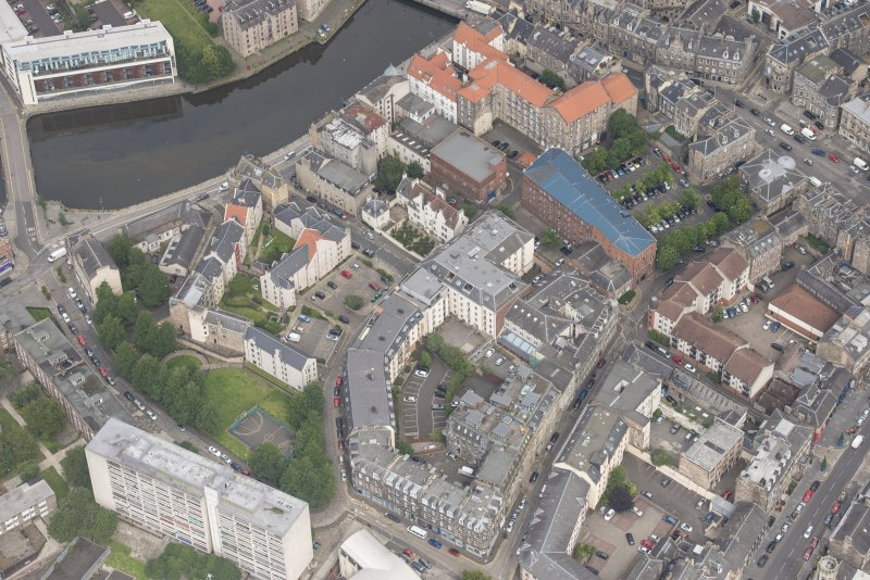 Oblique aerial view of 59-63 Bernard Street, the National Commercial Bank of Scotland, 24-25 Maritime Street, 27-31 Bernard Street, 36-37 Shore, Carpet Lane Flour Mill and Lamb's House, looking NNW.