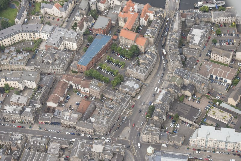 Oblique aerial view of 59-63 Bernard Street, the National Commercial Bank of Scotland, 24-25 Maritime Street, 27-31 Bernard Street, 36-37 Shore, Carpet Lane Flour Mill and Lamb's House, looking WNW.