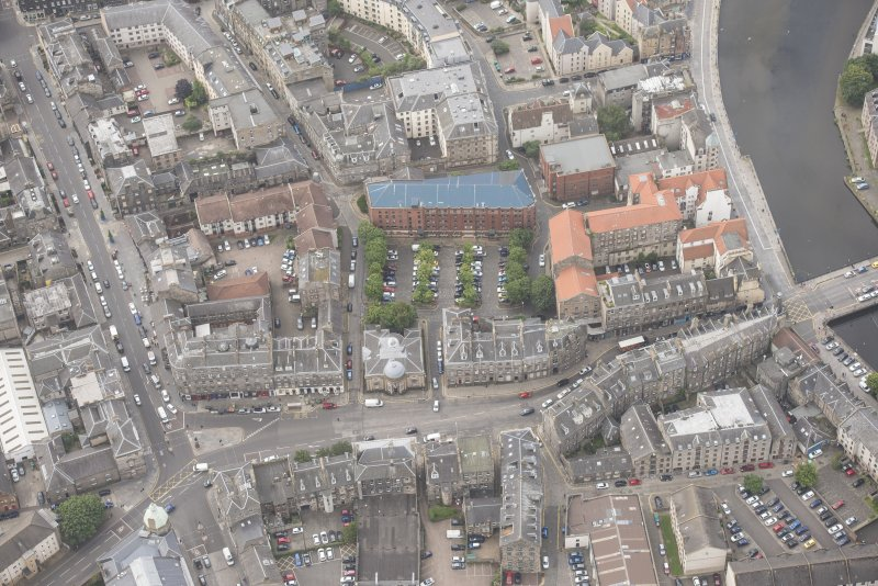 Oblique aerial view of 59-63 Bernard Street, the National Commercial Bank of Scotland, 24-25 Maritime Street, 27-31 Bernard Street, 36-37 Shore, Carpet Lane Flour Mill and Lamb's House, looking WSW.