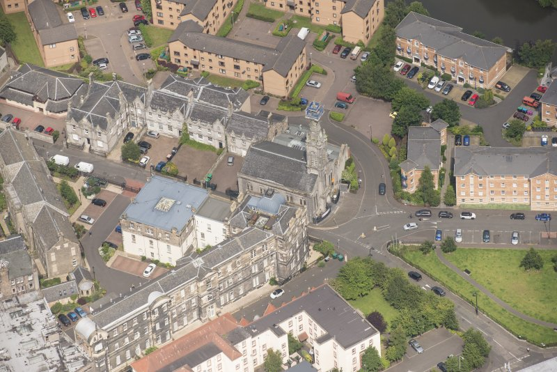 Oblique aerial view of St Thomas' Church and Leith Hospital, looking NNW.