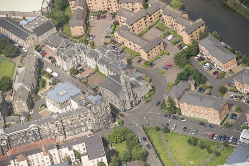 Oblique aerial view of St Thomas' Church and Leith Hospital, looking NW.