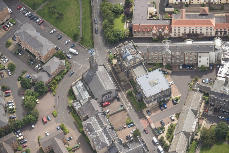 Oblique aerial view of St Thomas' Church and Leith Hospital, looking ESE.