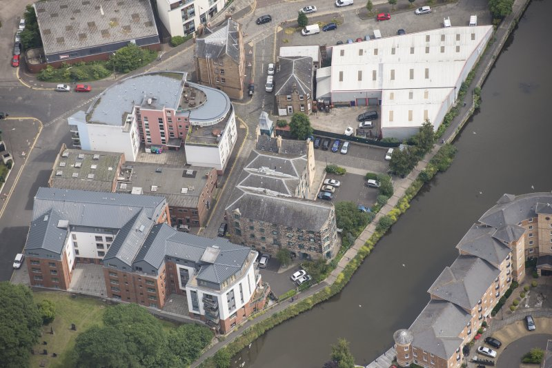 Oblique aerial view of Quayside Mills, looking E.