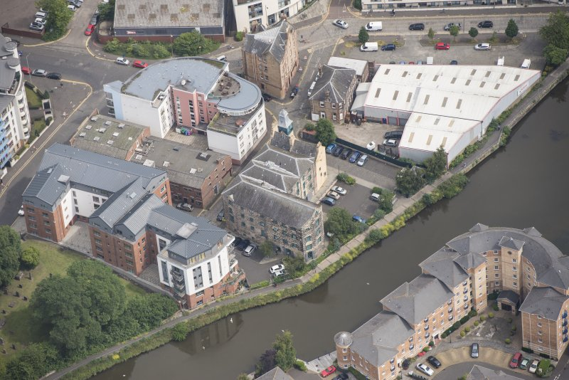 Oblique aerial view of Quayside Mills, looking NNE.
