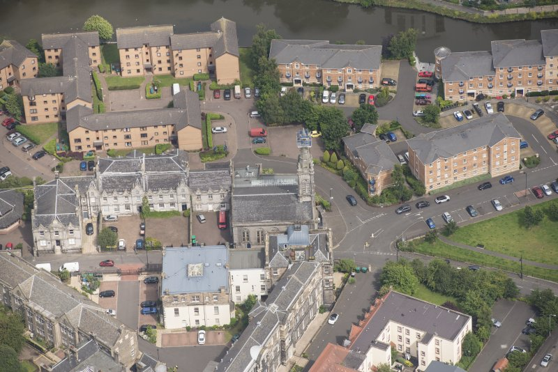 Oblique aerial view of Quayside Mills, looking N.