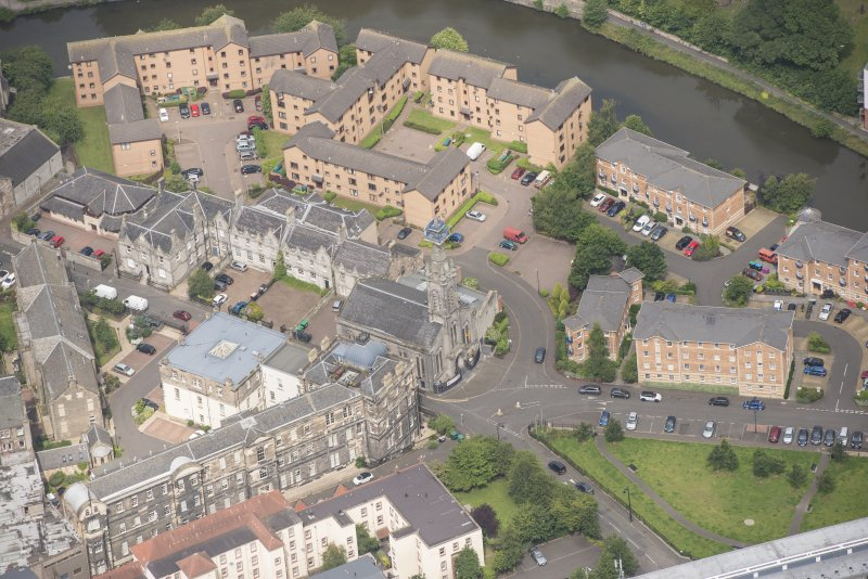 Oblique aerial view of St Thomas' Church and Leith Hospital, looking N.