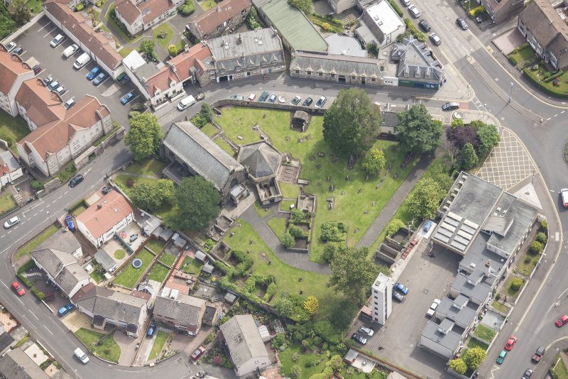 Oblique aerial view of St Triduana's Chapel, Restalrig Parish Church and Churchyard, looking ESE.