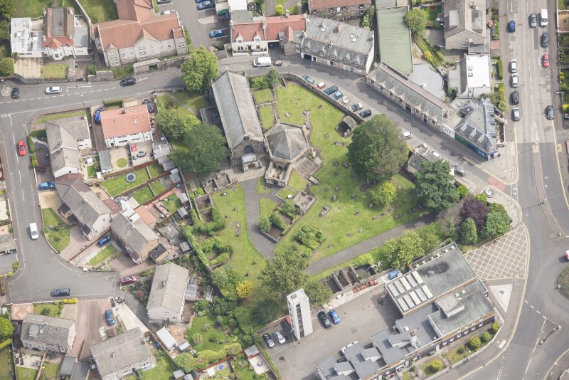 Oblique aerial view of St Triduana's Chapel, Restalrig Parish Church and Churchyard, looking E.