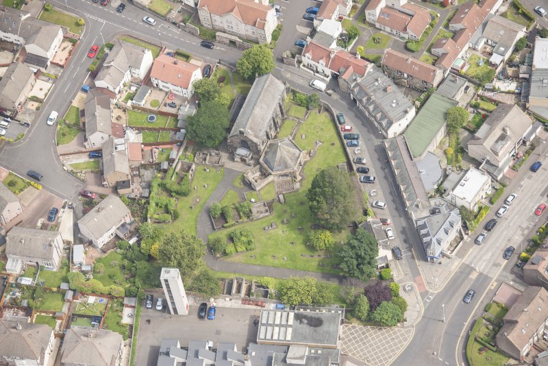 Oblique aerial view of St Triduana's Chapel, Restalrig Parish Church and Churchyard, looking NE.