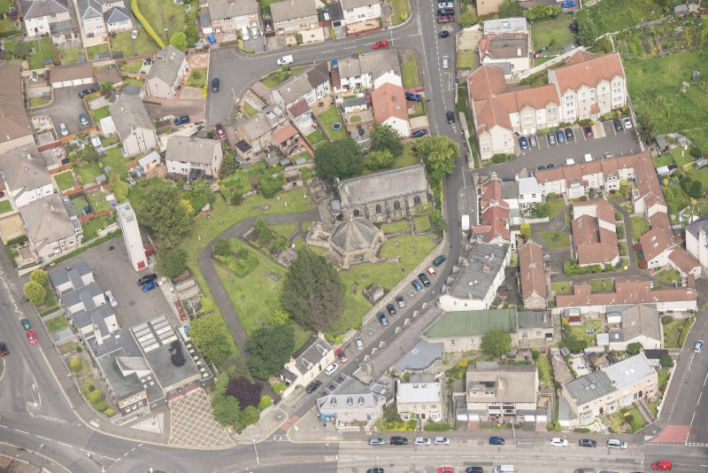 Oblique aerial view of St Triduana's Chapel, Restalrig Parish Church and Churchyard, looking N.