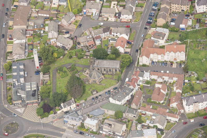 Oblique aerial view of St Triduana's Chapel, Restalrig Parish Church and Churchyard, looking NNW.