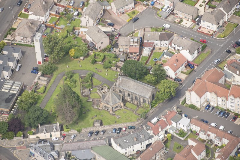 Oblique aerial view of St Triduana's Chapel, Restalrig Parish Church and Churchyard, looking NW.