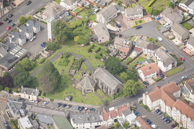 Oblique aerial view of St Triduana's Chapel, Restalrig Parish Church and Churchyard, looking WNW.