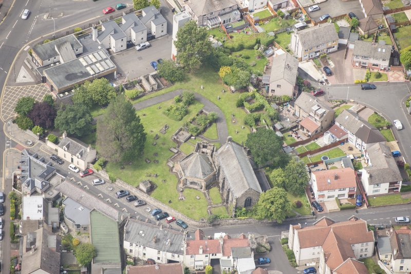 Oblique aerial view of St Triduana's Chapel, Restalrig Parish Church and Churchyard, looking W.