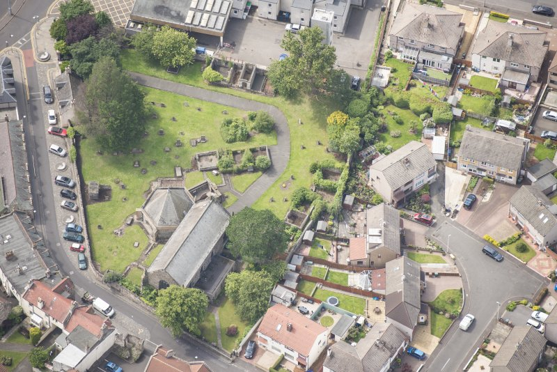 Oblique aerial view of St Triduana's Chapel, Restalrig Parish Church and Churchyard, looking SSW.